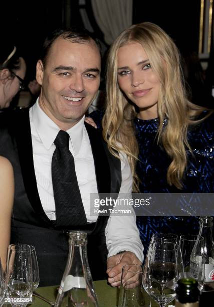 Milutin Gatsby and Kirstin Liljegren attend the amfAR Paris Dinner at The Peninsula Hotel on July 4 2018 in Paris France