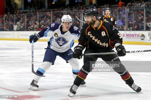 Milwaukee Admirals forward Eeli Tolvanen follows the puck into the corner as Cleveland Monsters defenceman Tommy Cross defends during the first...