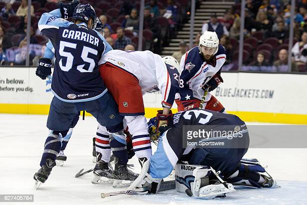 Milwaukee Admirals G Marek Mazanec makes a pad save as Milwaukee Admirals D Alexandre Carrier defends against Cleveland Monsters C Paul Bittner...