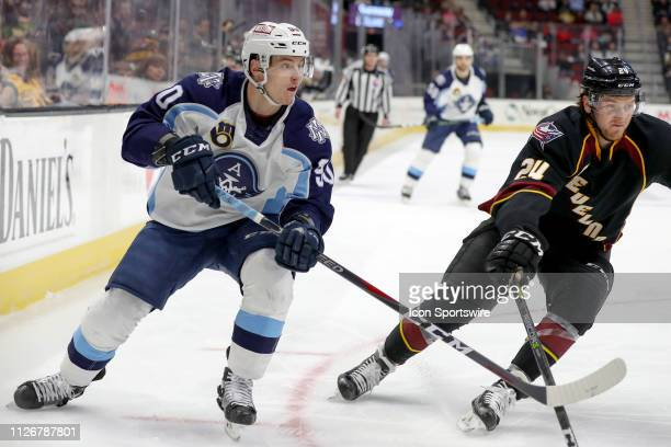Milwaukee Admirals left wing Anthony Richard is defended by Cleveland Monsters defenceman Michael Prapavessis during the first period of the American...