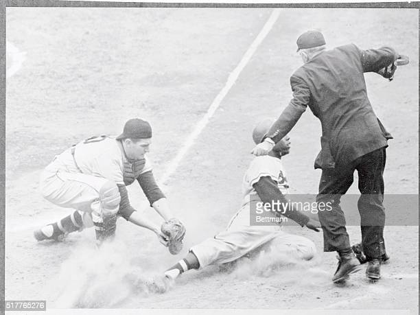 Milwaukee Braves' Hank Aaron being tagged out at plate by Pittsburgh's Jack Shepard as he tried to score from first on double by Bobby Thomson in 7th...