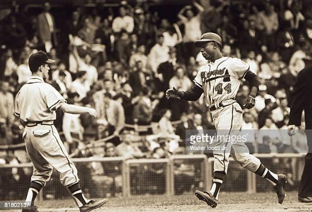 Milwaukee Braves Hank Aaron in action