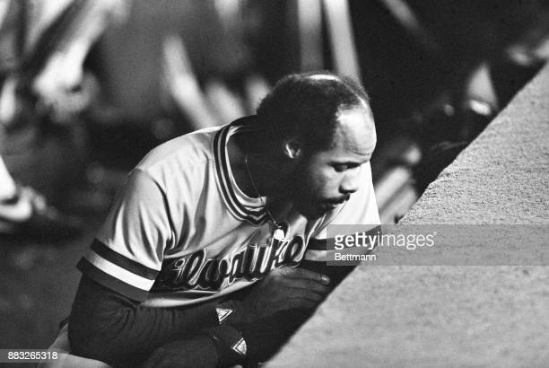 Milwaukee Brewer first baseman Cooper sits dejected in the Milwaukee dugout at the end of the final World Series game St Louis defeated Milwaukee 63...