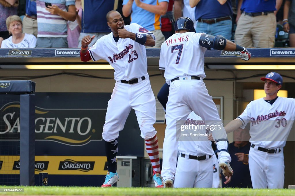 Milwaukee Brewers center fielder Keon Broxton (23) and Milwaukee Brewers first baseman Eric Thames (7) celebrate during a baseball game between the Milwaukee Brewers and the Baltimore Orioles at Miller Park on July 4, 2017 in Milwaukee, WI.