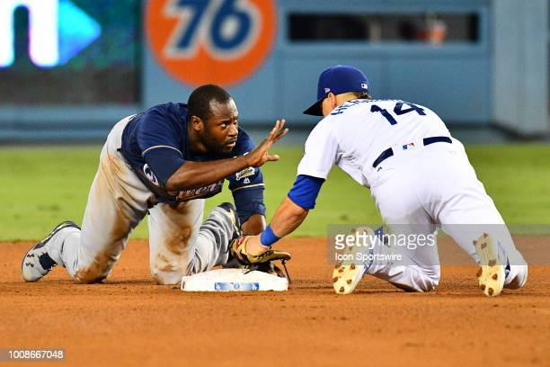 Milwaukee Brewers center fielder Lorenzo Cain slides safely ahead of the tag from Los Angeles Dodgers outfielder Enrique Hernandez during a MLB game...