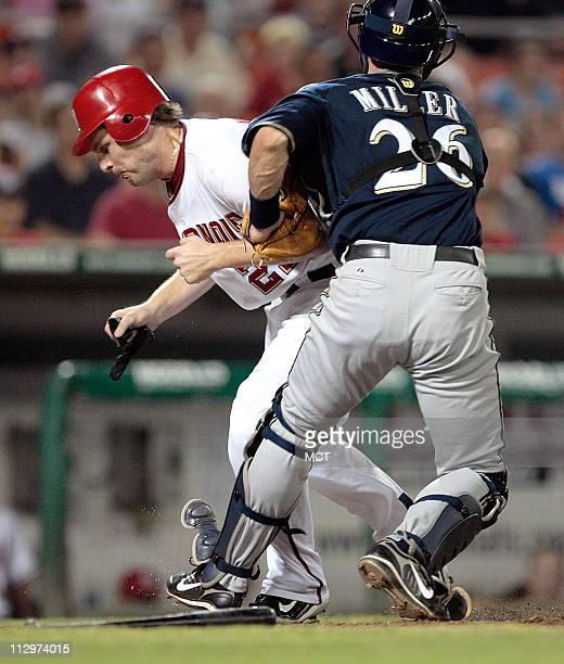 Milwaukee Brewers Damian Miller tags out Washington Nationals Austin Kearns at home plate during the 7th inning of their game played at RFK Stadium...