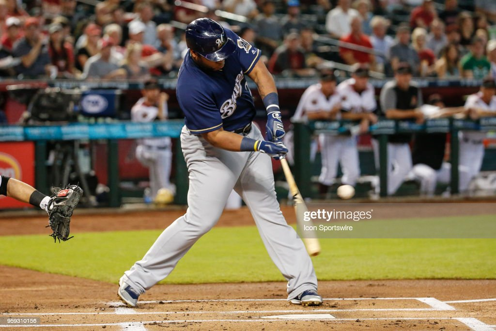 Milwaukee Brewers first baseman Jesus Aguilar (24) gets a hit during the MLB baseball game between the Milwaukee Brewers and the Arizona Diamondbacks on May 16, 2018 at Chase Field in Phoenix, Arizona.