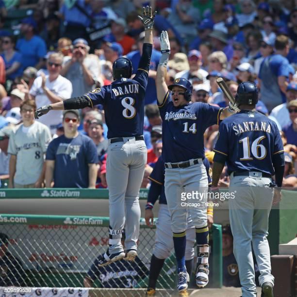 Milwaukee Brewers left fielder Ryan Braun and teammate Hernan Perez celebrate after Braun's tworun home run in the third inning against the Chicago...
