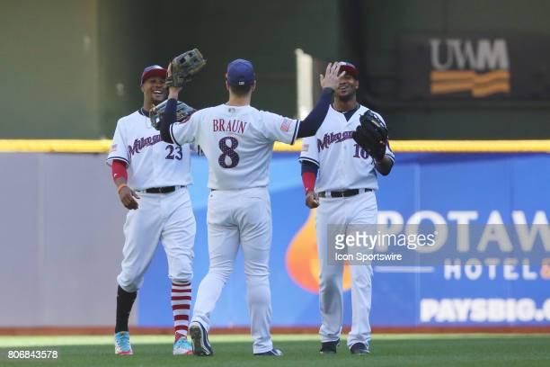 Milwaukee Brewers left fielder Ryan Braun celebrates with Milwaukee Brewers center fielder Keon Broxton and Milwaukee Brewers right fielder Domingo...
