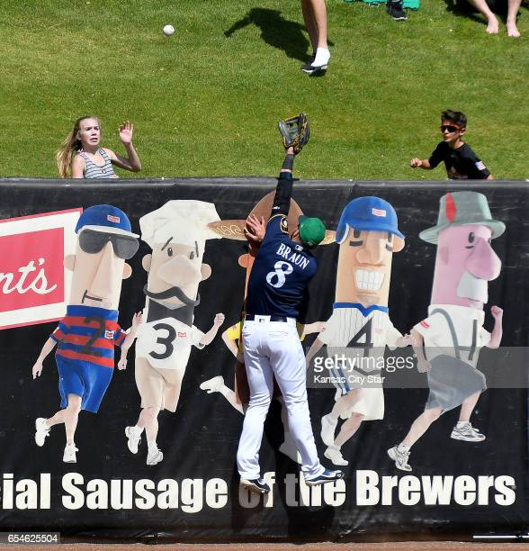Milwaukee Brewers left fielder Ryan Braun couldn't reach a home run ball hit by the Kansas City Royals' Christian Colon in the second inning during...