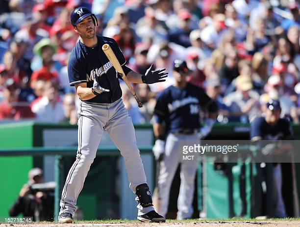 Milwaukee Brewers left fielder Ryan Braun watches as the bat slips from his hand on a swing and miss in third inning against the Washington Nationals...