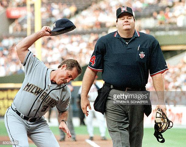 Milwaukee Brewers Manager Phil Garner throws his hat down after being thrown out of the game by home plate umpire Jerry Layne during the first inning...