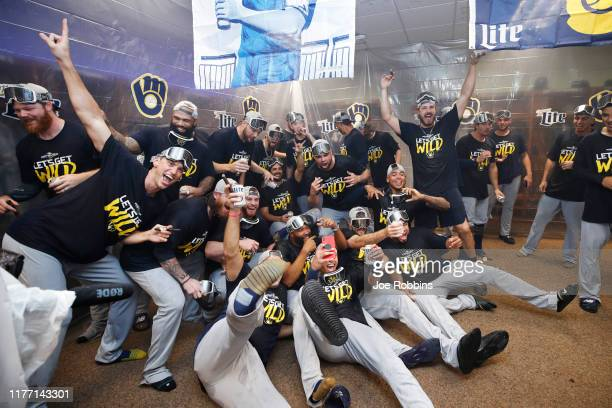Milwaukee Brewers players celebrate in the clubhouse after clinching a playoff berth following a 92 win over the Cincinnati Reds at Great American...