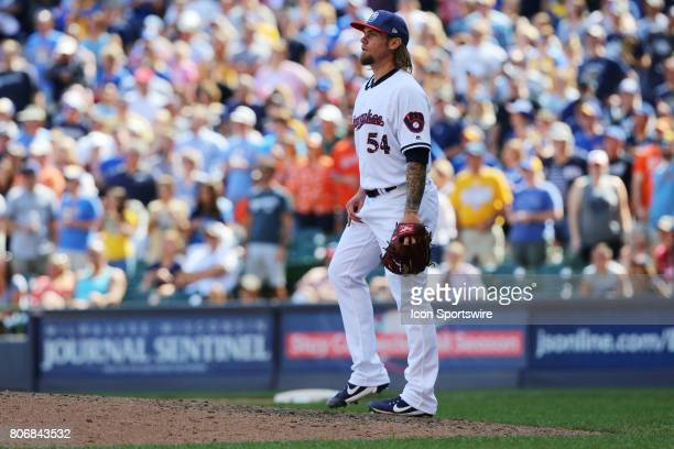 Milwaukee Brewers relief pitcher Michael Blazek watches the last out being made during a baseball game between the Milwaukee Brewers and the...