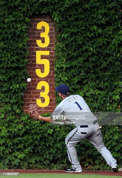 Milwaukee Brewers right fielder Corey Hart plays a ball off the wall that went for a double for Chicago Cubs hitter Derrek Lee in the first inning at...