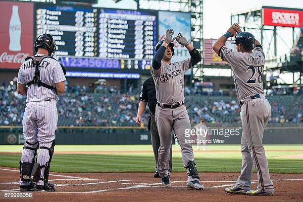 Milwaukee Brewers right fielder Ryan Braun celebrates a first inning tworun homer with left fielder Gerardo Parra as Colorado Rockies catcher Nick...
