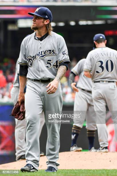 Milwaukee Brewers starting pitcher Michael Blazek is taken out of the game in the third inning by manager Craig Counsell after surrendering five home...