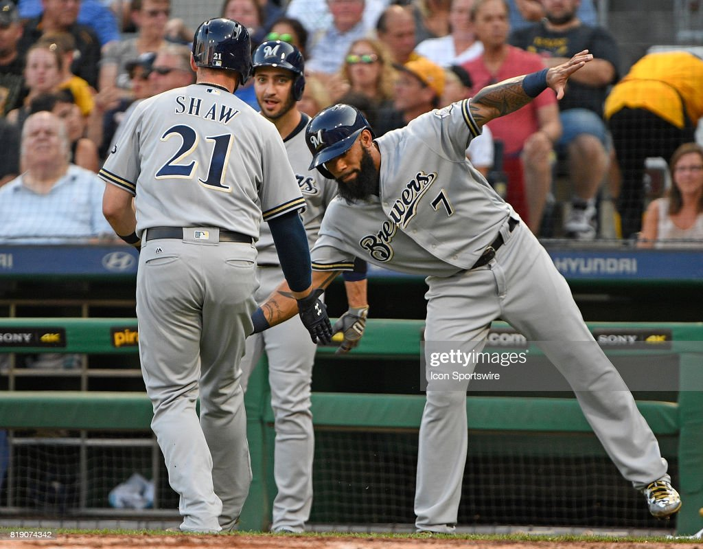 Milwaukee Brewers third baseman Travis Shaw (21) is met at home plate by first baseman Eric Thames (7) after hitting a three run home run in the third inning during the game against the Pittsburgh Pirates at PNC Park on July 18, 2017 in Pittsburgh, Pennsylvania.