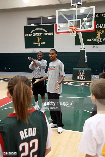 Milwaukee Bucks assistant coach Anthony Goldwire and guard Brandon Jennings work with participants during the YMCA basketball clinic on February 27,...