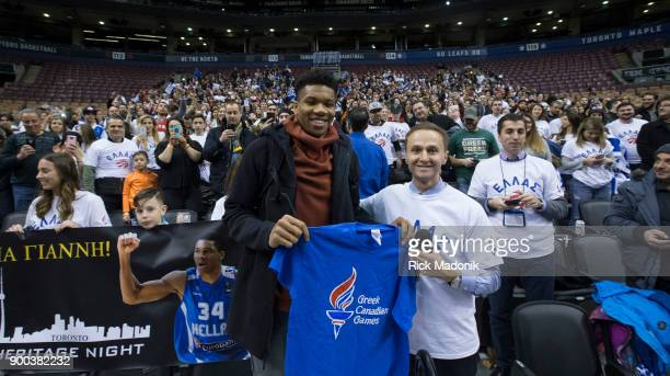 Milwaukee Bucks forward Giannis Antetokounmpo comes out and meets Greek fans following the game part of Greek Heritage Night Toronto GP Dr Frank Otis...