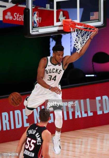 Milwaukee Bucks forward Giannis Antetokounmpo dunks for a basket against Miami Heat forward Jae Crowder and forward Kelly Olynyk during the first...