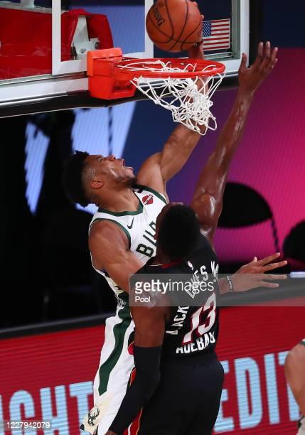 Milwaukee Bucks forward Giannis Antetokounmpo dunks to score a basket against Miami Heat forward Bam Adebayo during the first half of an NBA...