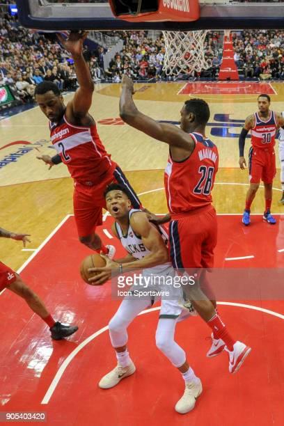 Milwaukee Bucks forward Giannis Antetokounmpo is fouled by Washington Wizards center Ian Mahinmi in the second half on January 15 2018 at the Capital...