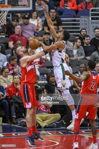 Milwaukee Bucks forward Giannis Antetokounmpo is fouled by Washington Wizards center Marcin Gortat on January 15 2018 at the Capital One Arena in...