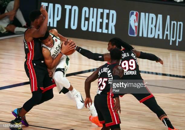 Milwaukee Bucks forward Giannis Antetokounmpo moves to the basket against the defense of Miami Heat forward Bam Adebayo forward Jae Crowder and guard...