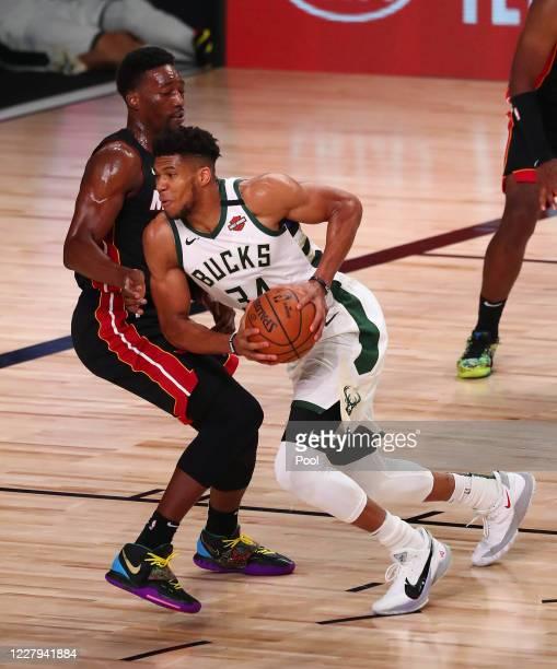 Milwaukee Bucks forward Giannis Antetokounmpo moves to the basket against Miami Heat forward Bam Adebayo during the first half of an NBA basketball...
