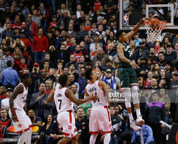 Milwaukee Bucks forward Giannis Antetokounmpo puts the nail in the proverbial coffin with an easy dunk for a 4 point lead with 7 seconds left Toronto...