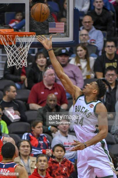 Milwaukee Bucks forward Giannis Antetokounmpo scores against the Washington Wizards on January 15 2018 at the Capital One Arena in Washington DC