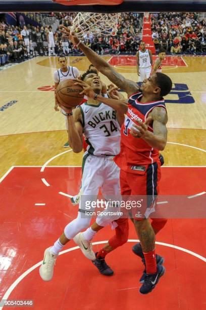 Milwaukee Bucks forward Giannis Antetokounmpo scores against Washington Wizards guard Bradley Beal on January 15 2018 at the Capital One Arena in...