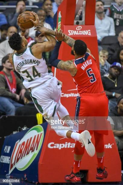 Milwaukee Bucks forward Giannis Antetokounmpo scores and is fouled by Washington Wizards forward Markieff Morris on January 15 2018 at the Capital...