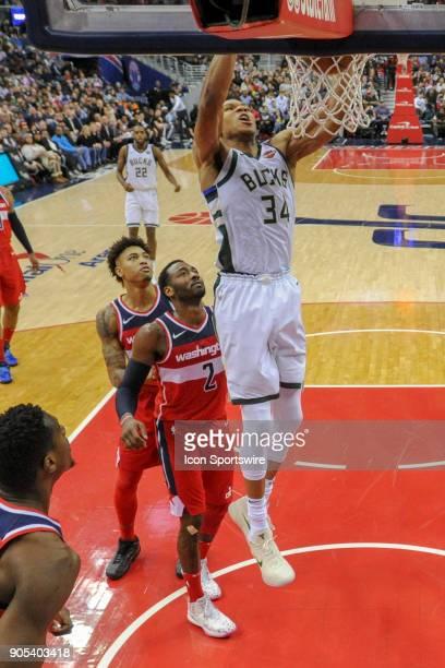 Milwaukee Bucks forward Giannis Antetokounmpo scores in the second half against Washington Wizards guard John Wall on January 15 2018 at the Capital...