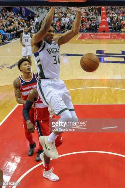 Milwaukee Bucks forward Giannis Antetokounmpo scores in the second half against the Washington Wizards on January 15 2018 at the Capital One Arena in...