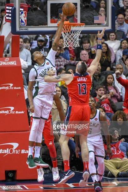 Milwaukee Bucks forward John Henson blocks the shot of Washington Wizards center Marcin Gortat in the second half on January 15 2018 at the Capital...