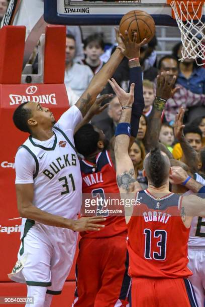 Milwaukee Bucks forward John Henson blocks the shot of Washington Wizards guard John Wall on January 15, 2018 at the Capital One Arena in Washington,...