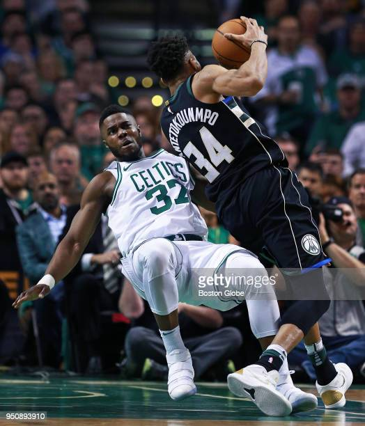 Milwaukee Bucks' Giannis Antetokounmpo knocks down the Celtics' Semi Ojeleye on a second quarter drive to the hoop The Boston Celtics host the...