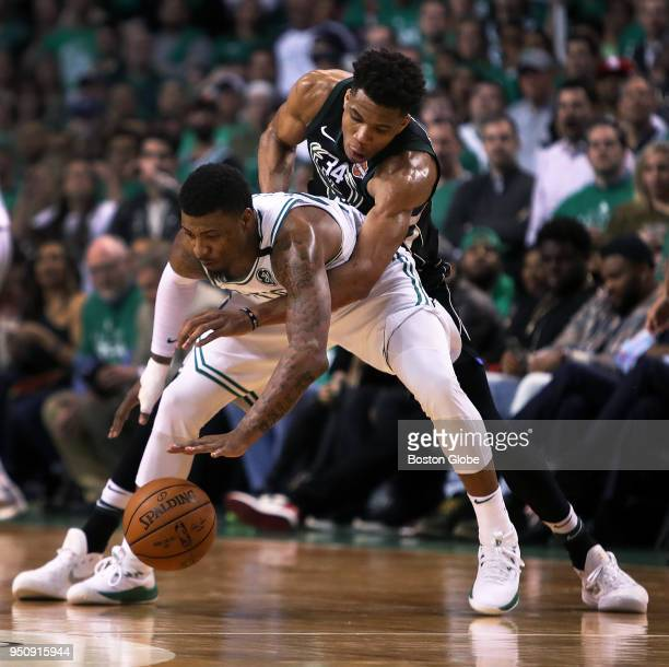 Milwaukee Bucks' Giannis Antetokounmpo unsuccessfully tries to reach for a steal around the Celtics' Marcus Smart The Boston Celtics host the...