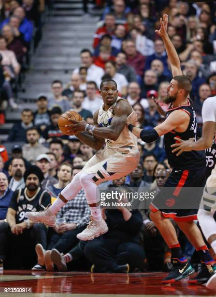 Milwaukee Bucks guard Eric Bledsoe looks to pass after coming up against Toronto Raptors center Jonas Valanciunas . Toronto Raptors vs Milwaukee...