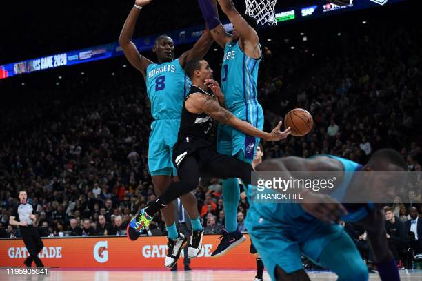 Milwaukee Bucks guard George Hill fights for the ball with Charlotte Hornets centre Bismack Biyombo during the NBA basketball match between Milwaukee...
