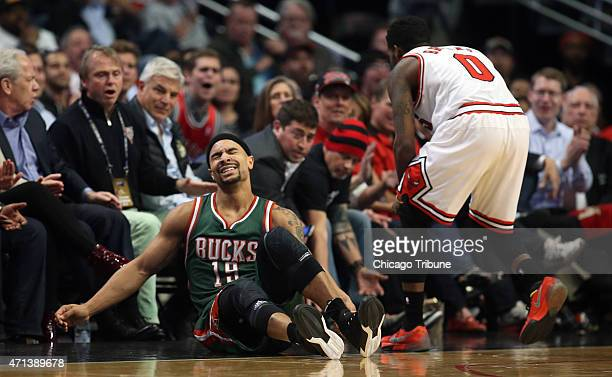 Milwaukee Bucks guard Jerryd Bayless falls out of bounds while Chicago Bulls guard Aaron Brooks defends during the first half on Monday April 27 at...