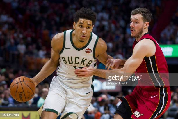 Milwaukee Bucks guard Malcolm Brogdon fights to get past Miami Heat guard Goran Dragic in the fourth quarter on Sunday Jan 14 2018 at the...