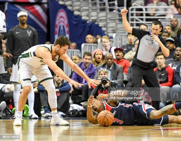 Milwaukee Bucks guard Matthew Dellavedova commits a flagrant foul on Washington Wizards guard Bradley Beal and was ejected from the game during...