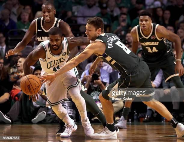 Milwaukee Bucks guard Matthew Dellavedova pokes the ball away from Boston Celtics guard Kyrie Irving during the third quarter. The Boston Celtics...
