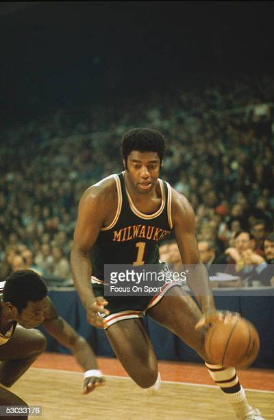 Milwaukee Bucks' guard Oscar Robertson dribbles the ball downcourt during a game. NOTE TO USER: User expressly acknowledges and agrees that, by...