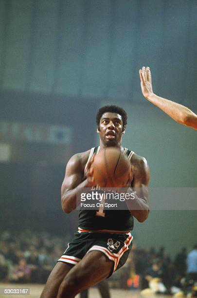Milwaukee Bucks' guard Oscar Robertson eyes the basket and shoots during a game NOTE TO USER User expressly acknowledges and agrees that by...
