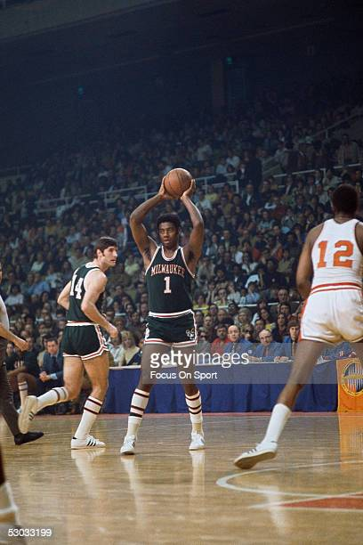 Milwaukee Bucks' guard Oscar Robertson passes to a teammate during a game NOTE TO USER User expressly acknowledges and agrees that by downloading...