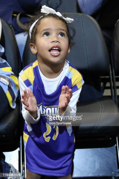Milwaukee Bucks guard Wesley Matthews daughter looks up at her image on the jumbotron during a game between the Marquette Golden Eagles and the...